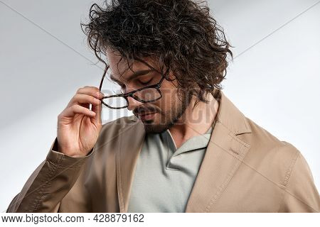 Middle-aged Man, Stylishly Dressed In A Gray T-shirt And Glasses, Business Style, Smart Kezhl, Hands