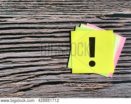 Exclamation Mark Concept. Colorful Sticky Note Written Exclamation Mark Isolated On Wooden Backgroun