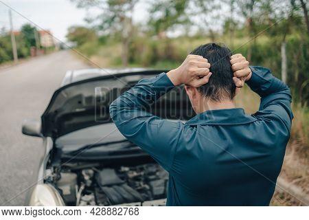 Serious Man Headache Front Of Car Breakdown And Open Bonnet On Roadside. Car Broken Concept.