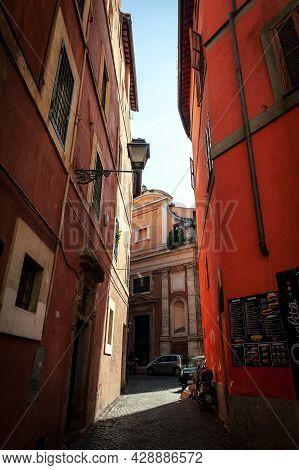Rome, Italy - October 2019: View Of Small Alley Of Vicolo Della Campanella Towards Oratory Of San Ce
