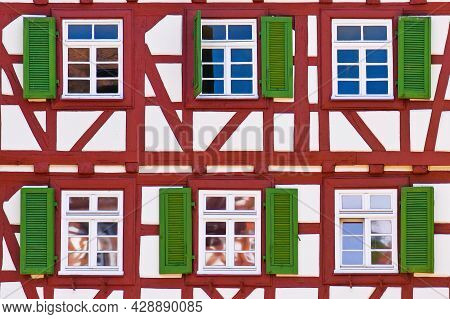 Mosbach, Germany - June 2021: Facade Of Old Historic Timber Framing Building With Red Timber Beams A