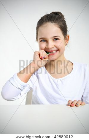Little girl eating candy