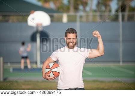 Summer Activity. Happy Muscular Man With Basketball Ball. Sport Trainer Or Basketball Player