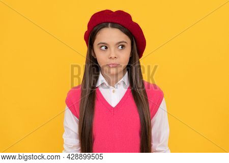 Kid Looking Away. Serious Kid In Beret. Child Has Long Hair. Skin Beauty. Tween And Youth.