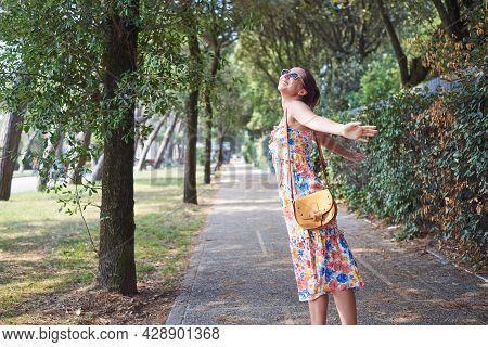 Beautiful woman portrait on street. Happy people lifestyle. Woman portrait while walking on street. Woman lifestyle. Happiness. Lifestyle. Concept of happy lifestyle. Happy people. Happy young woman portrait. Happiness concept. Young people. Woman Portrai
