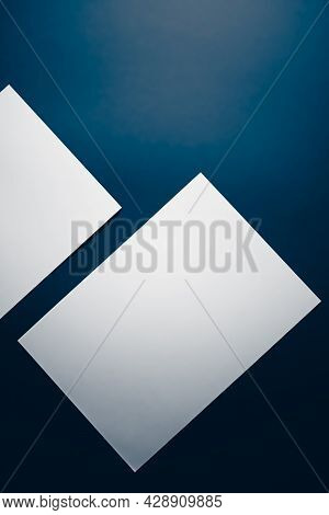Blank A4 Paper, White On Blue Background As Office Stationery Flatlay, Luxury Branding Flat Lay And