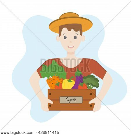 Young Farmer Holds The Wooden Box With Organic Vegetables. Organic Farming Concept, Local Farmers Ma