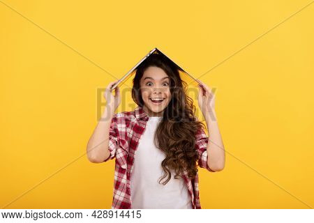 Happy Tween Girl Smile Holding Laptop Computer On Head Yellow Background, Distance Education