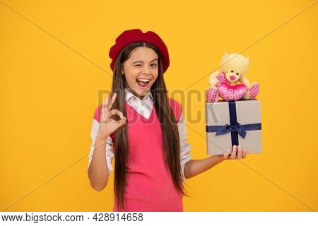 Happy Teen Girl In French Beret Hold Toy Present And Gift Box Show Ok Gesture, Present