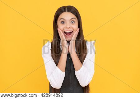Surprised Primary School Kid In Uniform Yellow Background, Surprise