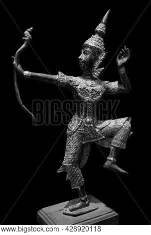 Prince Rama statue with a bow. Archer, Rama of Hinduism sculpture isolated on black background