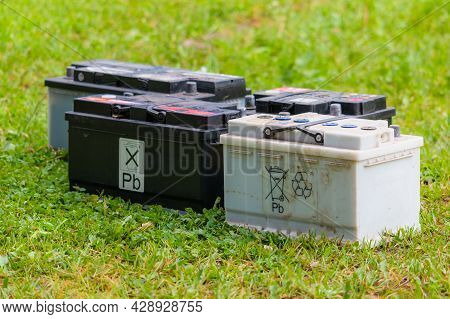 Pb Lead Car Batteries On A Grass In The Nature
