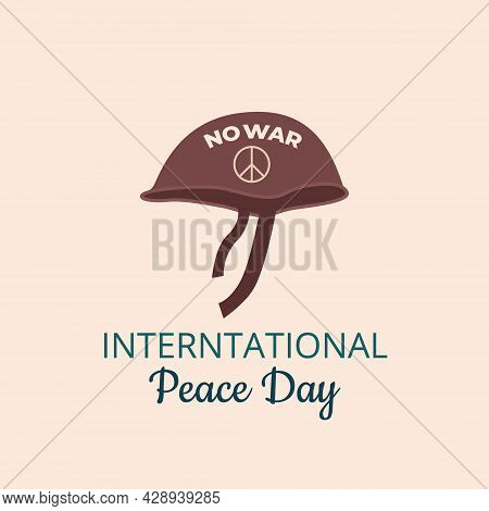 Army Helmet With Pacific Symbol And No War On It With The Inscription World Day Of Peace. Internatio