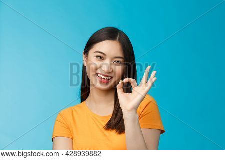Close-up Cute Asian Friendly Girl Supports Your Fantastic Idea, Smiling Broadly, Show Okay Ok Sign A
