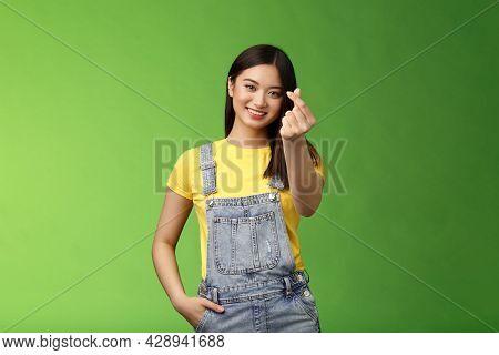 Lovely Tender Carefree Asian Girlfriend Show Korean Love Sign, Make Finger Heart Smiling Cute, Showi