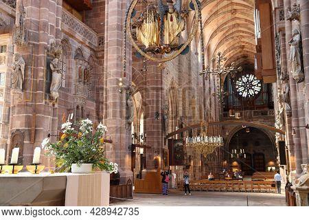 Nuremberg, Germany - May 8, 2018: People Visit St. Lorenz Kirche (saint Lawrence Church) In Nurember