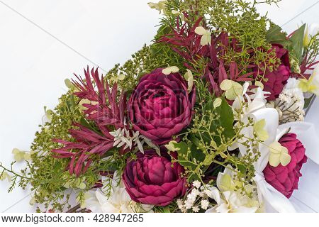Wedding Bouquet On The Car With Ribbon On A White Background