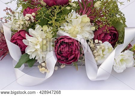 Wedding Bouquet On The Car With White Ribbon