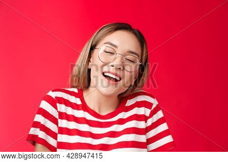Happy Dreamy Glad Asian Girl Feel Stuffed Good After Eating Favorite Sandwich, Woman Wear Glasses Cl
