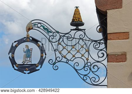 Kaysersberg, France, June 26, 2021 : Stores Ensign In The Traditional Alsacian Architecture, In One