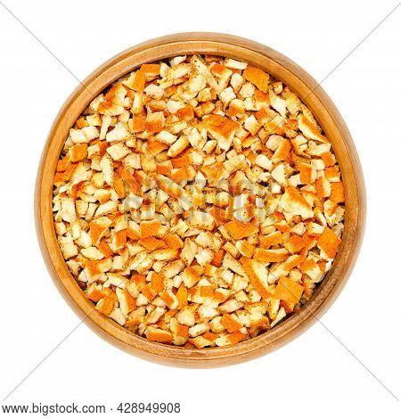 Dried Organic Orange Peel, Cut Into Coarse Pieces, In A Wooden Bowl. Cut Skin Of Organic Oranges, Us