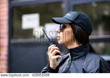 Professional Security Guard Officer Using Walkie Talkie