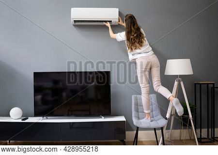 Home Safety And House Accident. Woman Using Chair Reaching Ac