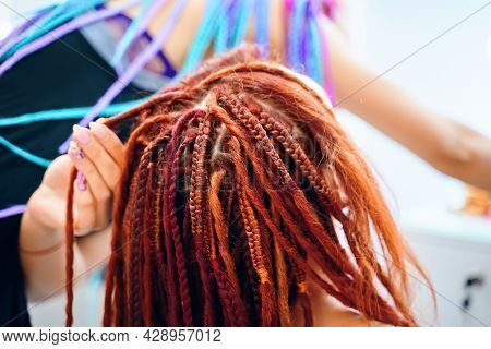 Stylish Therapy Professional Care Concept. Hippie Style Hairstyle. Braiding Process Plait With Color