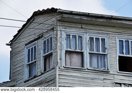 Old Wooden House. Open Windows Of A Wooden House. Window Frames With Peeling Paint.
