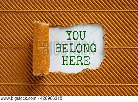 You Belong Here Symbol. Words 'you Belong Here ' Appearing Behind Torn Brown Paper. Beautiful Brown