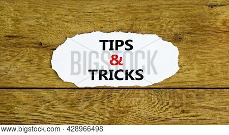 Tips And Tricks Symbol. Words 'tips And Tricks' On White Paper. Beautiful Wooden Background. Busines