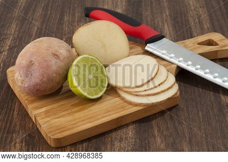Preparation Sliced Potatoes With Lemon; Photo On Wooden Background