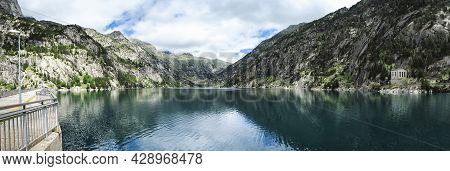 Panoramic View Of The Cavallers Reservoir Surrounded By High Mountains, River Noguera De Tor In Riba