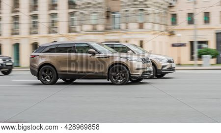 Moscow, Russia - August 2021: Two Suv Cars Racing At High Speed On City Highway With Motion Blur. Be