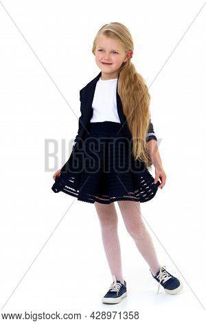 Cute Girl Elementary School Student. Cute Long Haired School Girl Wearing Blue Jacket And Skirt Posi