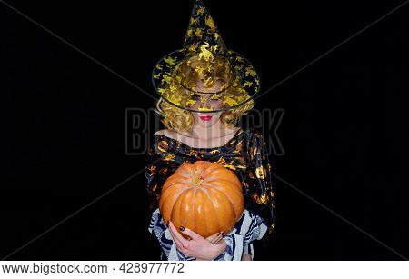 Happy Halloween. Smiling Woman In Witch Hat With Pumpkin. Pretty Girl In Witches Costume With Jack-o