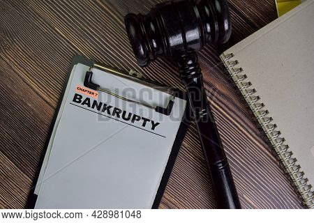 Bankrupty Chapter 7 Write On A Paperwork Isolated On Wooden Table.