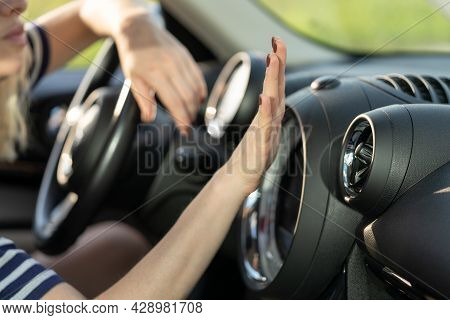 Female Hand Checking Air Conditioning Panel Inside Car. Woman Driver Suffer From Heat In Vehicle Hol