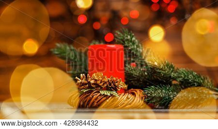 Christmas Candles And Lights. Burning Candles Over Old Wooden Table With Bokeh Lights. Festival Cand