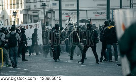 ATHENS, GREECE - APRIL 15, 2015: Riot police and protesters during a protest in front of Athens University, which is under occupation by protesters leftist and anarchist groups.