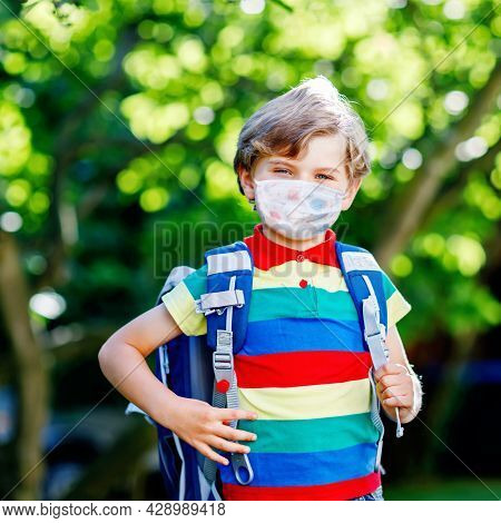 Happy Little Kid Boy, Medical Mask And Backpack Or Satchel. Schoolkid On Way To School. Healthy Chil