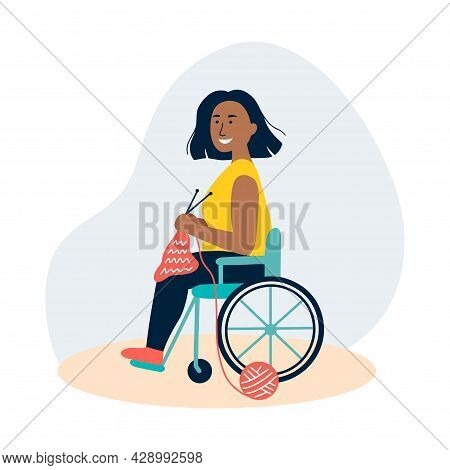 An African Woman Knits In A Wheelchair. The Concept Of Employment For People With Special Needs, Hob