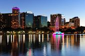 Orlando downtown skyline panorama over Lake Eola at dusk with urban skyscrapers and clear sky. poster