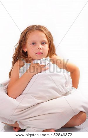 Attractive Little Girl With A Pillow