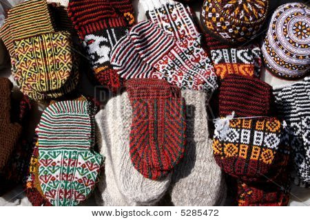 Knit slippers with traditional ornament. Turkmenistan. Ashkhabad market. poster