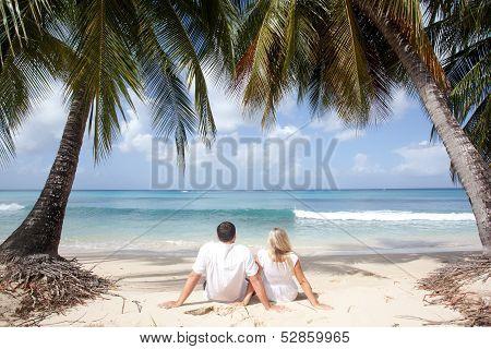 Couple Sitting On The Beach