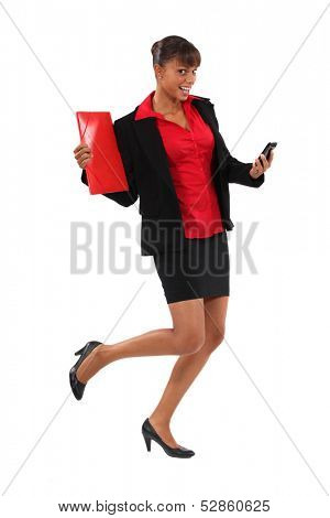Excited businesswoman holding folder and cellphone poster