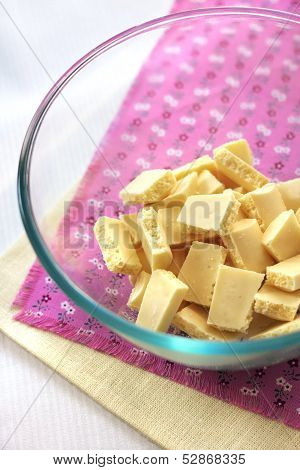 Bar Of White Chocolate Broken Into Pieces