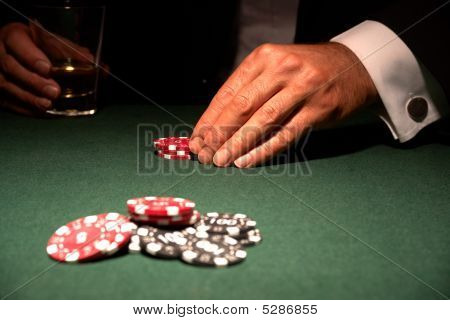 Card Player In Casino With Chips