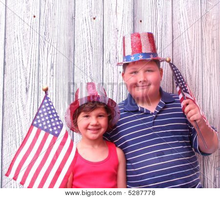 Boy And Girl At 4Th Of July